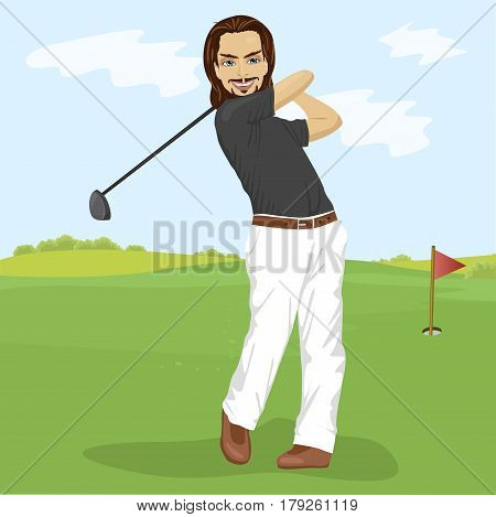 Male golfer hitting golf shot with club on the course