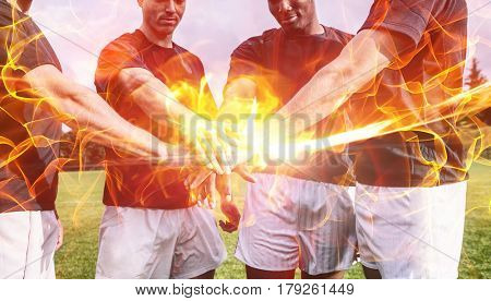 Ball of fire against rugby players standing together before match 3d