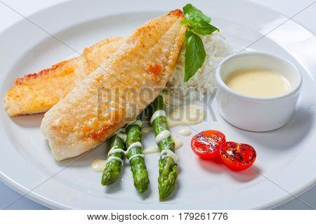 Delicious Fish Steak With Green Asparagus And Rice