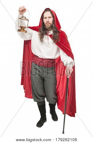 Medieval Man In Cape With Cane And Lamp Isolated