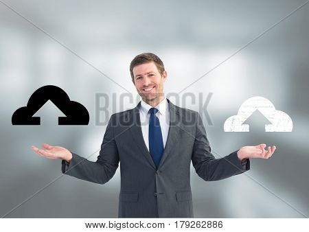 Digital composite of Man choosing or deciding cloud uploads icons with open palm hands