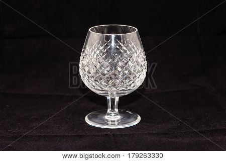 crystal goblet (five and a half inches tall, three and a half wide)