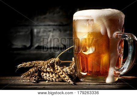 Light beer and wheat near brick wall