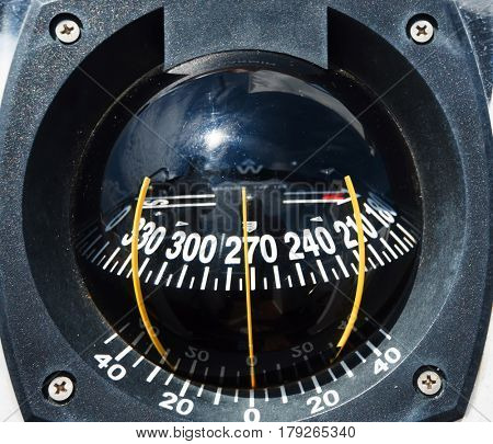 Magnetic compass. Traveling, seafaring, navigation, shipping concept.