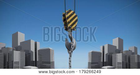Studio Shoot of a crane lifting hook against blue sky background