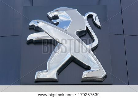 Villefranche, France- March 5, 2017: Peugeot logo on a wall. Peugeot is a French cars brand, part of peugeot Citroen automobile group