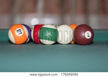 Pool balls isolated on pool table background