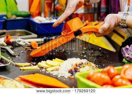 Man Cook Grating Vegetables