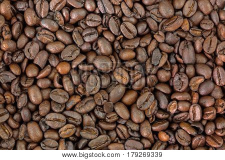 Closeup texture of very dark brown roasted Robusta coffee beans