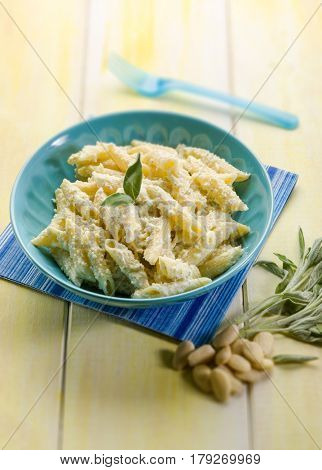 pasta with ricotta almond pesto and sage, selective focus