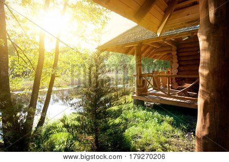 Wooden house and pond at the sunrise