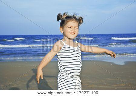 Baby girl on the beach under sunlight asian mestizo