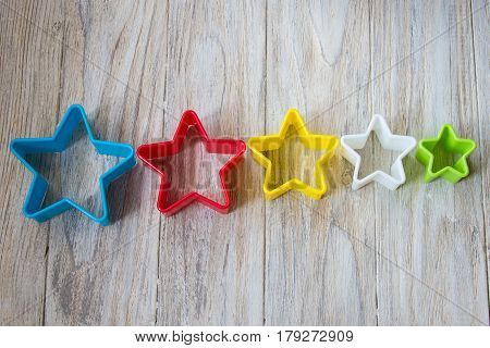 Bakeware in shape star on a wooden background. Close up