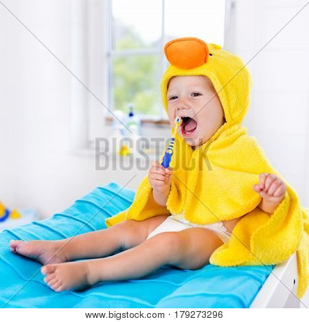 Baby In Bath Towel With Tooth Brush