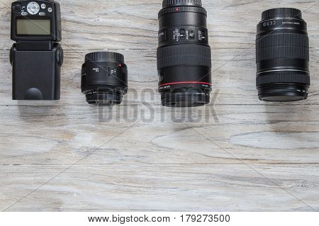 Camera lens well organized over wooden background. Top view