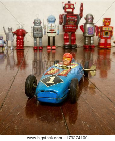 retro tin wind up race car on wooden floor