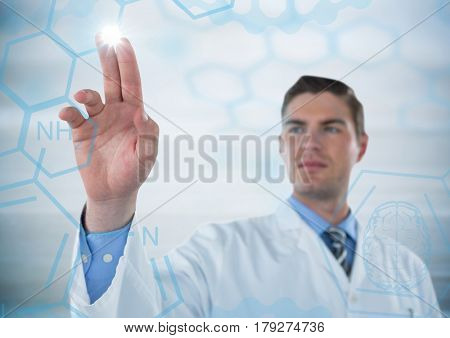 Digital composite of Man in lab coat pointing at blue medical interface with flare against grey background