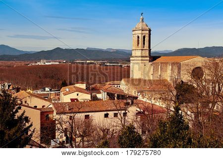 a view of Girona, in Spain, seen from above highlighting the bell tower of the Cathedral