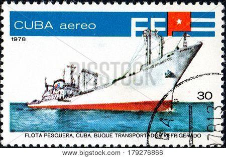 UKRAINE - CIRCA 2017: A postage stamp printed in Cuba shows fish factory ship Oceano Atlantico series Fishing Fleet circa 1978