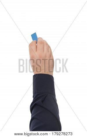 Hand holding eraser isolated on white background.