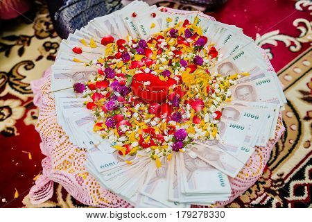 Dowry (money) on flower tray in Thai traditional wedding