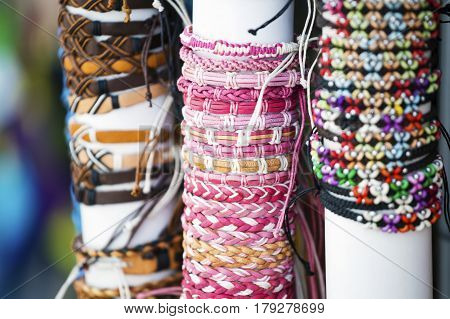 A set of colorful bangles on display at a local store