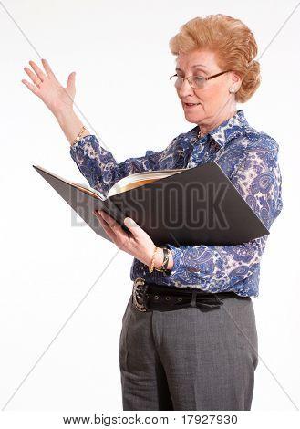 Elegant senior lady reading aloud