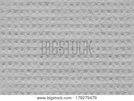 Gray texture of porous spongy material close-up. Abstract fabric background for design