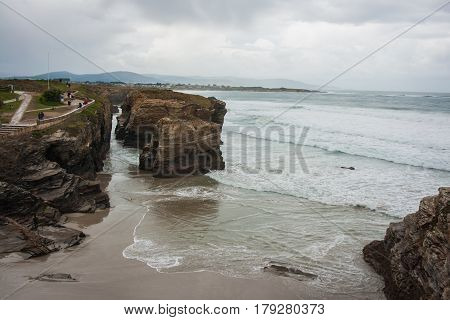 Seascape with the arc between the cliffs of the seacoast, Cathedral beach, Galicia, Spain