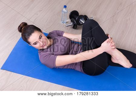 Sport Concept - Top View Of Slim Woman Doing Stretching Exercises On The Floor