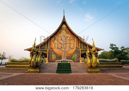 Temple Sirindhorn Wararam Phuproud in Ubon Ratchathani Province with sunset sky Thailand.
