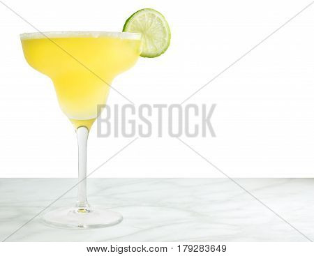 A photo of a lemon Margarita cocktail with a wedge of lime and a place for text