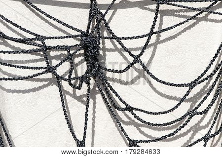 tangled black nylon rope, white backgrounded close-up