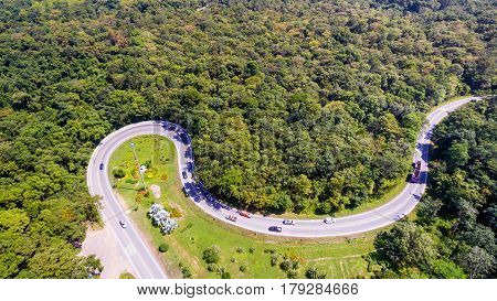 Aerial View Of Cars Are Going Through A Curve Road On The Mountain