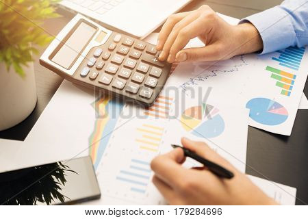 businesman working on stock market graphs and charts