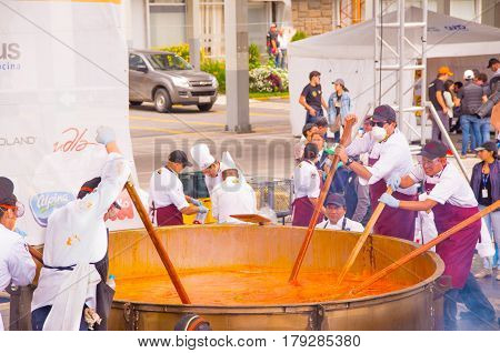 Quito, Ecuador - March 5, 2017: Preparation of the biggest traditional locro potato soup in Locro Fest, an event organized to achieve a Guinness World Record.