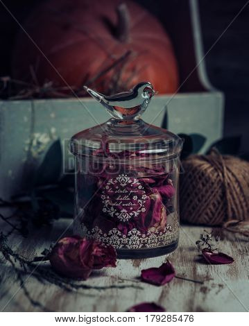 Rose buds tea, tea strainer and glass jar. Selective focus.
