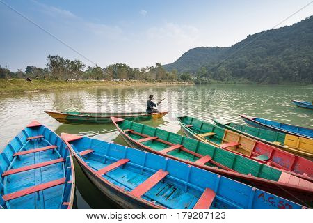 Pokhara, Nepal - Dec 19: Unidentified Man On Colourful Wooden Boat At Fewa Lake On December 19, 2015