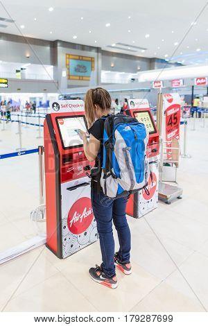 Bangkok - Mar 29: Tourist At Air Asia Self Check-in Service Counter At Don Mueang International Airp