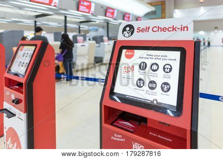 Bangkok - Mar 29: Air Asia Self Check-in Service Counter At Don Mueang International Airport On Marc