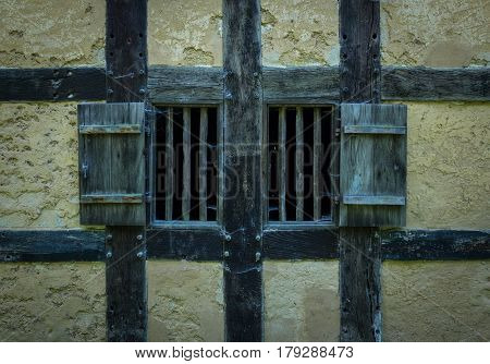 Wooden Shutters In The Wall Of An Old Adobe House