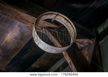 Old Sieve On The Ceiling In A Rustic Barn