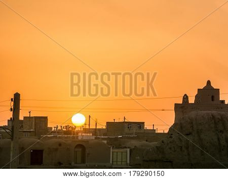View on orange sunset over village in iran