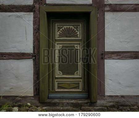 The Old Wooden Door Of The Farmhouse