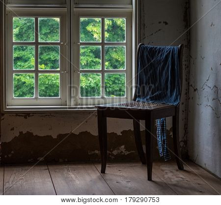 The Old And Wooden Chair In A Room