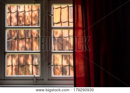 The Window With Curtain Of An Old Farmhouse Inside