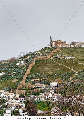 View of Ermita de San Miguel Alto with wall from Generalife gardens Granada Spain