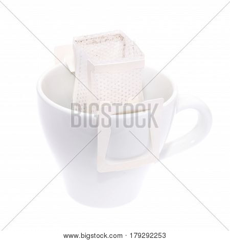 Drip Bag Coffee Hanging On A Coffee Cup Isolated On White Background.