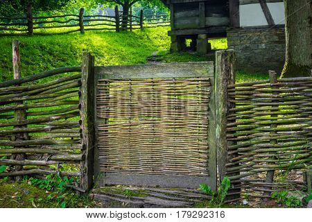 The Old And Wooden Fence Of A Farmyard