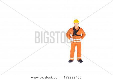 Close Up Of Miniature People In Engineer And Worker Occupation Isolate On White Background. Elegant